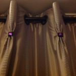 Eyelet headed curtains with handmade goblet pleats finished with handmade glass buttons